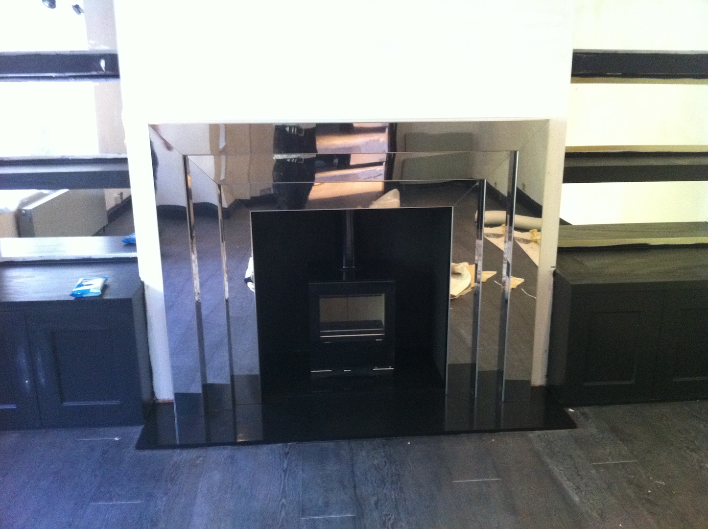 Highly polished Stainless Steel fire surround